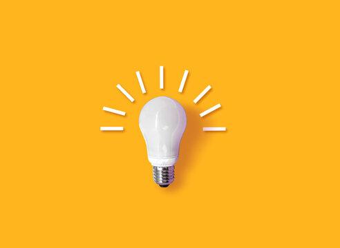 idea light bulb on orange background.  creativity inspiration ,planning ideas concept
