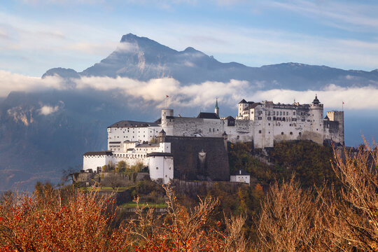 Hohensalzburg Fortress. Image of Hohensalzburg Fortress with mountain range in the background located in Salzburg, Austria at beautiful autumn sunrise.