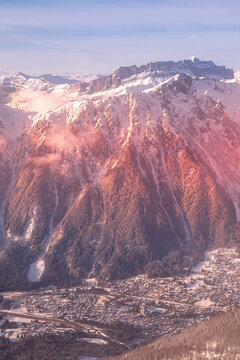 Chamonix Mont-Blanc french ski resort town sunset aerial view, France, French Alps mountains panorama