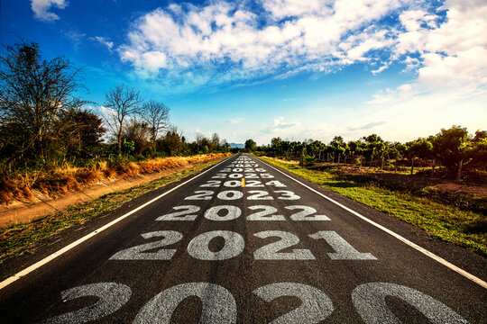 2020-2030 written on highway road in the middle of empty asphalt road and beautiful blue sky. Concept for vision 2020-2030.