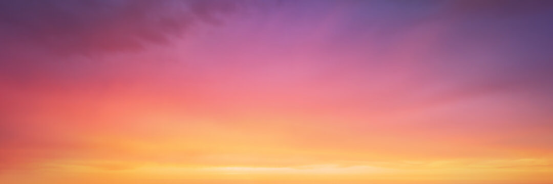 panorama of cloudscape at sunset with vivid and dreamy colors on sky