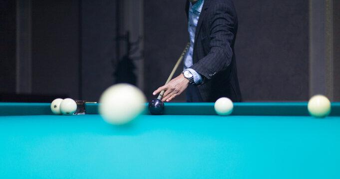 Billiards game - Close-up shot of a man playing billiards