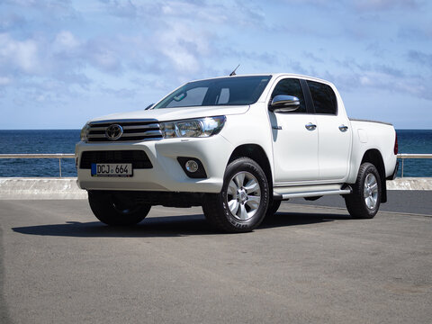 BARCELONA, SPAIN-APRIL 29, 2020: 2016 Toyota Hilux Invincible (GUN125R), Eighth generation at city streets next to sea