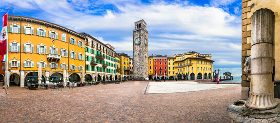 Riva del Garda - charming popular town in Garda lake. Colorful houses and old tower in downtown. Italy, Tentino