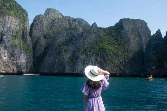 Woman traveler looking to Maya Bay on Phi Phi Leh Island, Krabi Province.