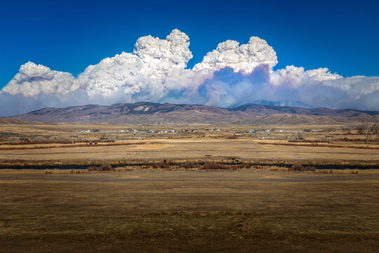 Thick smoke clouds over the Rocky Mountains in Colorado from the Cameron wildfires