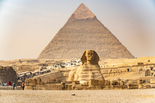 Tourists visit the pyramids and sphinx in Giza, Egypt
