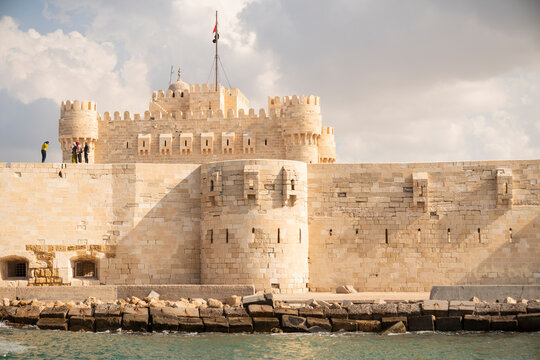 A castle surrounded by a fortress wall in Alexandria, Egypt