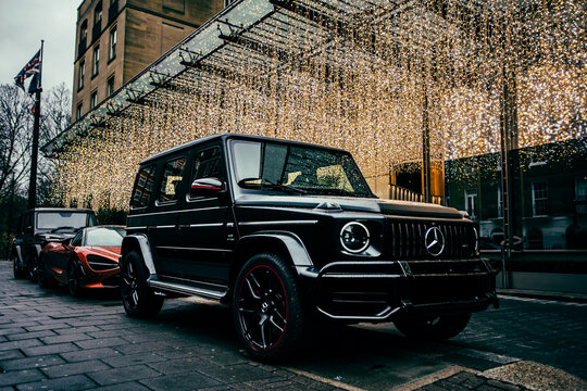 Mercedes G-Class and McLaren 720s parked in front of the Berkeley Hotel decorated for Christmas in London, UK on December 4th, 2018