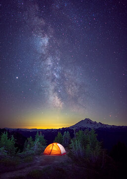 A tent is under the Milky Way on the top of a mountain, Washington, US