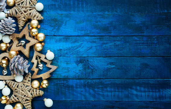 A Christmas wooden natural decoration ornament; wide horizontal banner background with copyspace