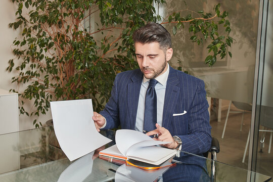 Business man signing a contract in big office. Finance, agree.