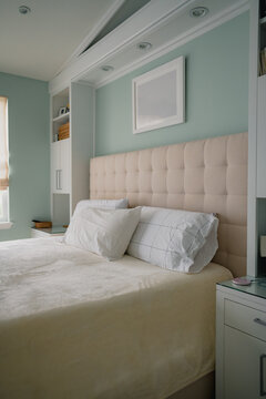 vertical interior bedroom photo with built in shelving
