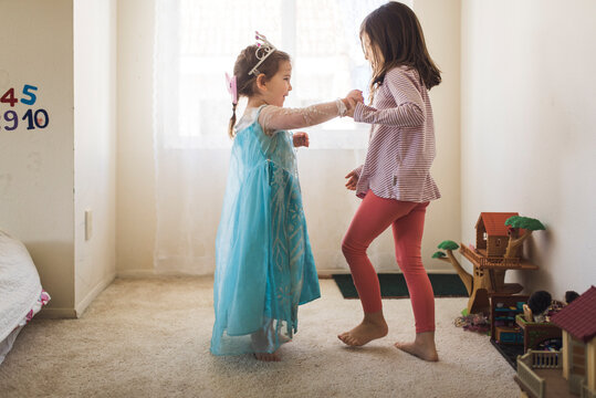 Barefoot 6 yr old dancing with 4 yr old sister in princess costume
