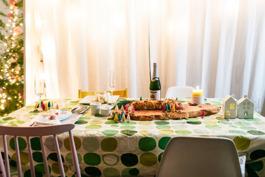 Decorated  holidays dinner table at single home with green table circle cloth