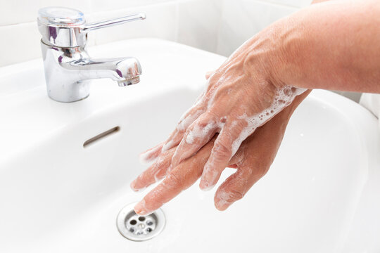Woman washing her hands and disinfecting them for Coronavirus disease