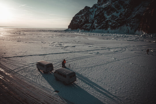 old vans over frozen baikal lake