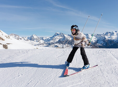 a boy skiing on the white snow of Formigal with Pyrenees mountains on background. Horizontal photo