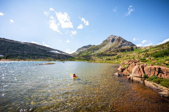 Floating On a Sleeping Pad on Alpine Lake at Limestone Lakes