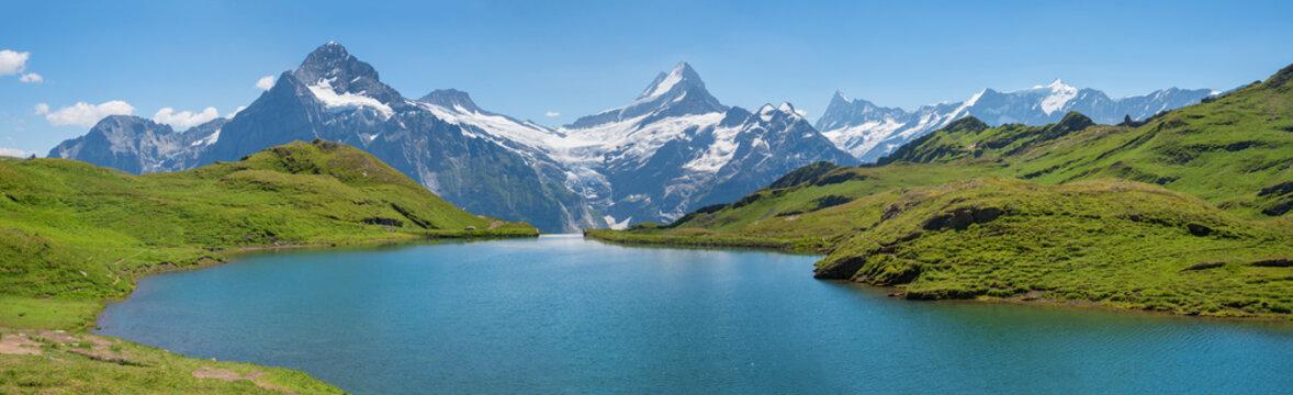 idyllic alpine lake Bachalpsee, tourist destination near Grindelwald, beautiful landscape switzerland
