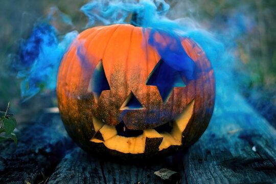 a halloween pumpkin head with smoke