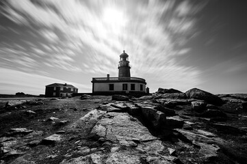 Galician lighthouse under a sea of clouds Fotomurales