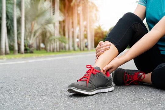 fitness woman runner feel pain on ankle leg. Outdoor exercise ac