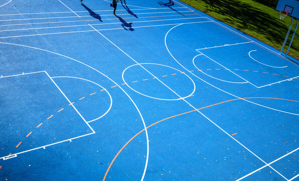 Blue Sports Court A detail of a colored sports court, lines and shadow
