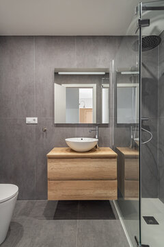 Stylish bathroom interior with countertop, mirror and shower. Minimalist style