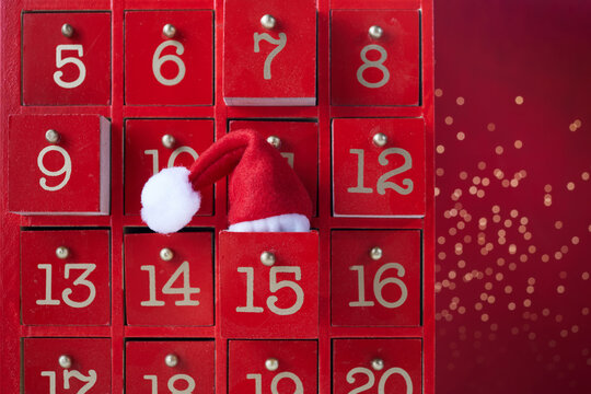 Red wooden Advent calendar with surprise for Christmas