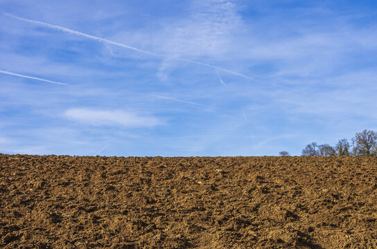 Ploughed Arable Land - A sunny ploughed arable land in spring.