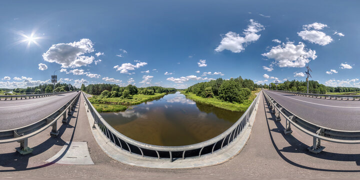 full seamless spherical hdri panorama 360 degrees on concrete bridge with solar panels near asphalt road across river in sunny summer day in equirectangular projection, AR VR virtual reality content