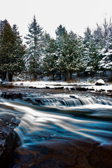 river in the snowy forest