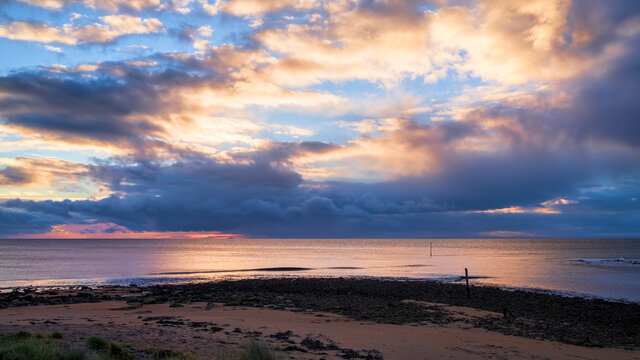Sunrise and dawn sky over the North Sea off the mouth of the River Brora in Sutherland in the Highlands