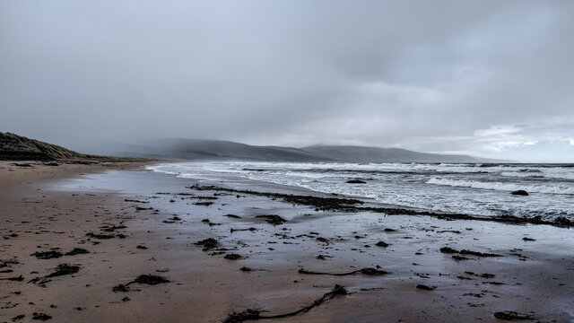 Stormy seas and rain clouds on Brora beach in the Highlands