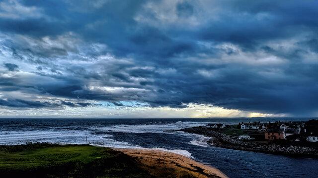 Stormy seas, the River Brora estuary, the North Sea and Lower Brora