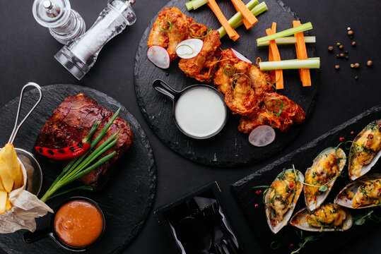 Asian-style chicken wings, fresh vegetables