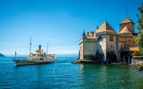 Montreux touristic steamboat on Lake Geneva and Chillon castle view with clear blue sky in Vaud Switzerland