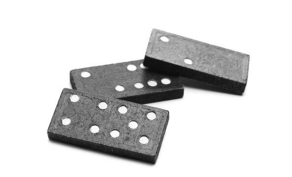 Black dominoes pile isolated on white background