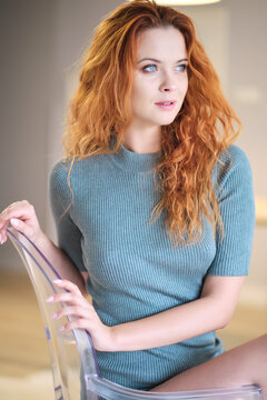 attractive young redhead woman at home