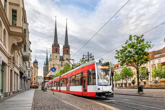 Halle (Saale), Germany. Red tram going on Hallmarkt square in front of Marktkirche church in old town