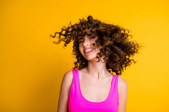 Photo of pretty overjoyed lady good mood chilling having fun feel warm sea summer breeze skin eyes closed wavy hairdo flight wear pink singlet tank-top isolated shine yellow color background