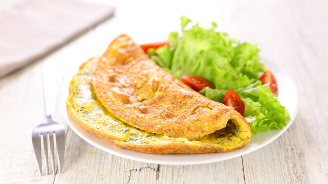 plate of omelet and salad
