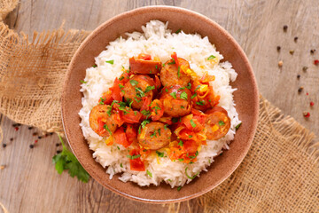 creole dish- rougail- sausage with spicy tomato sauce and rice