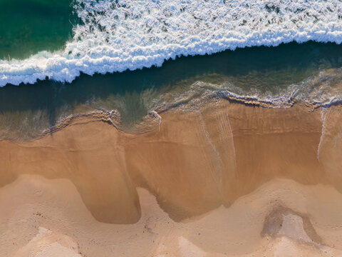 (Top view) Beach seawater wave on sandy beach. Background and travel concept.