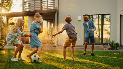 Fototapeta Happy Family of Four Playing with Garden Water Hose, Spraying Each Other. Mother, Father, Daughter and Son Have Fun Playing Games in the Backyard Lawn of Idyllic Suburban House on Sunny Summer Day obraz