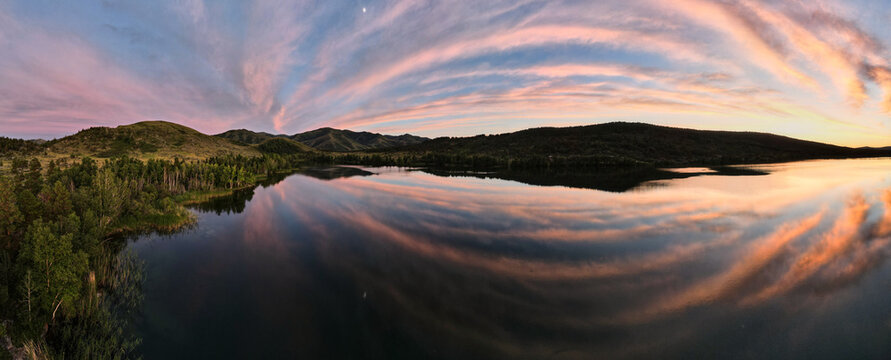 Panorama of the sunset sky over a beautiful lake