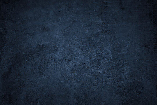 Dark grunge background. Black blue abstract rough background. Toned concrete wall texture.