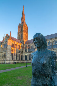 View of Salisbury Cathedral and statue at sunset, Salisbury, Wiltshire