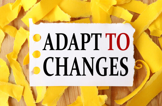 adapt to changes, text on white paper with torn paper background